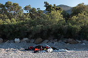 Abandoned life jackets and tyre inner tubes left by Syrian refugees on the coastline of the Greek island Chios. The refugees made the 5 hour crossing from Turkey to Chios packed 50 to an inflatable rubber boats. The coastline is littered with the remains of the slashed boats and life savers.