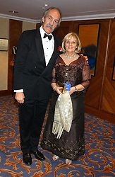MR & MRS ROGER UTTLEY at the annual SPARKS Winter Ball in the presence of HRH Princess Michael of Kent held at the London Hilton Hotel, Park Lane, London W1 on 15th December 2005.<br />