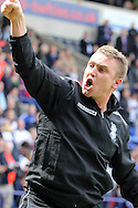Birmingham City's manager Lee Clark celebrates with the traveling fans after his side drew to stay in the Championship. Skybet football league championship match , Bolton Wanderers v Birmingham city at the Reebok stadium in Bolton on Saturday 3rd May 2014.<br /> pic by David Richards, Andrew Orchard sports photography.
