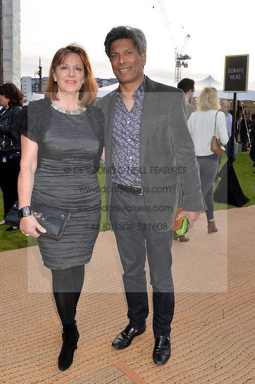 DES GUNEWARDENA Chairman / Ceo Of D&D London and his wife LIZ GUNEWARDENA at the Battersea Power Station Annual Party at Battersea Power Station, 188 Kirtling Street, London SW8 on 30th April 2014.