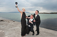 Páidí Ó Lionáird, TG4 and Aengus Mac Grianna, RTÉ News try  to get their hands on the covetted Oireachtas Media award  from TG4 Rugby presenter Máire Treasa Ní Dhubhghaill who took time out on the Salthill beach from the Oireachtas Media Awards held in the Galway Bay Hotel, Salthill, Galway . These awards celebrate the TV & Radio Presenters , actors, Journalists and programme makers who have excelled in their contribution to the Irish language media sector in the last twelve months. Photo:Andrew Downes.