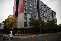 © Licensed to London News Pictures . 11/10/2018. Salford , UK . GV of Holm Court with temporary cladding fitted on lower floors and unsafe cladding remaining in place above . Recently installed cladding at several council-owned tower blocks in Salford has been identified as having similar dangerous properties to that which was installed on the Grenfell Tower in London . Residents have been waiting months for clarification on what action will be taken to make their homes safe . Photo credit : Joel Goodman/LNP