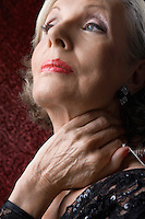 Senior Woman with Hand on Neck