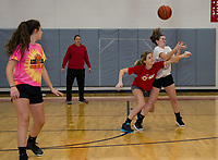 Girls basketball coach Erica Knolhoff works on defensive drills with Morgan Hall, Elaina Hoey and Chloe Sottak during Tuesday afternoons practice at Belmont High School.  (Karen Bobotas/for the Laconia Daily Sun)