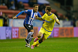 James Tavernier of Wigan is challenged by Joe Mattock of Sheffield Wednesday - Photo mandatory by-line: Rogan Thomson/JMP - 07966 386802 - 30/12/2014 - SPORT - FOOTBALL - Wigan, England - DW Stadium - Wigan Athletic v Sheffield Wednesday - Sky Bet Championship.