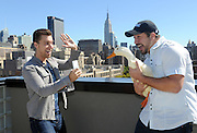 Lance Bass, left, Joey Fatone and the Aflac Duck enjoy the New York City skyline, Monday, Sept. 23, 2013, during Advertising Week.  The Aflac Duck is celebrating his comeback from injuries that left him unable to quack.  (Photo by Diane Bondareff/Invision for Aflac/AP Images)