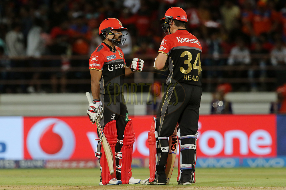 Kedar Jadhav of the Royal Challengers Bangalore and Travis Head of the Royal Challengers Bangalore during match 20 of the Vivo 2017 Indian Premier League between the Gujarat Lions and the Royal Challengers Bangalore  held at the Saurashtra Cricket Association Stadium in Rajkot, India on the 18th April 2017<br /> <br /> Photo by Vipin Pawar - Sportzpics - IPL