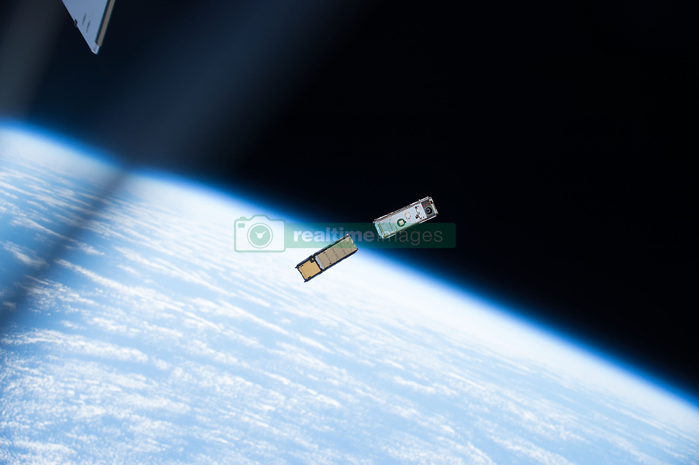 May 16, 2017 - Space - A pair of CubeSats, with the Earth's limb in the background, moments after being ejected from a small satellite deployer outside of the International Space Station's Kibo laboratory module The tiny shoebox-sized satellites will orbit Earth observing the Earth's upper atmosphere and interstellar radiation left over from the Big Bang. Over a dozen CubeSats were ejected into Earth orbit this week outside the Kibo module to study Earth and space phenomena for the next one to two years. (Credit Image: ? NASA via ZUMA Wire/ZUMAPRESS.com)