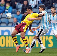 Mark Hudson of Huddersfield Town battles with Andre Gray of Burnley during the Sky Bet Championship match at the John Smiths Stadium, Huddersfield<br /> Picture by Graham Crowther/Focus Images Ltd +44 7763 140036<br /> 12/03/2016