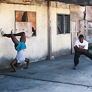 Ghana. Accra. The small and poor area of Bukom is the heartbeat of Ghanian boxing and has produced several world class fighters. Boxers train in a local gym, squats and push ups.