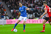 Christian Burgess of Portsmouth (6) in action during the EFL Sky Bet League 1 first leg Play Off match between Sunderland and Portsmouth at the Stadium Of Light, Sunderland, England on 11 May 2019.