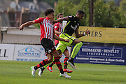 forward Vadaine Oliver gets away from defender Troy Brown during the Sky Bet League 2 match between Exeter City and York City at St James' Park, Exeter, England on 22 August 2015. Photo by Simon Davies.