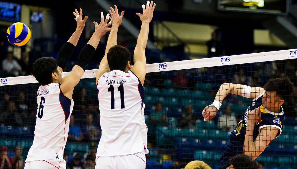 Qingyao Dai (14) of China spikes the ball on Korea's Hak-Min Kim (6) and Min-Ho Choi (11) at a World League Volleyball match at the Sasktel Centre in Saskatoon, Saskatchewan Canada on June 26, 2016.
