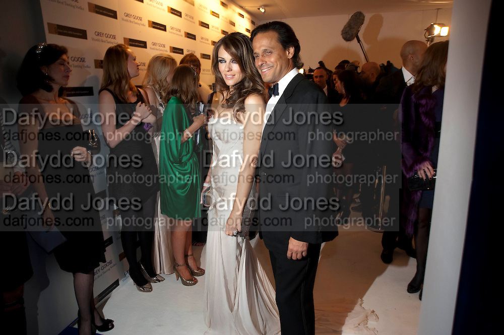 ELIZABETH HURLEY; ARUN NAYAR, Grey Goose character and cocktails. The Elton John Aids Foundation Winter Ball. off Nine Elms Lane. London SW8. 30 October 2010. -DO NOT ARCHIVE-© Copyright Photograph by Dafydd Jones. 248 Clapham Rd. London SW9 0PZ. Tel 0207 820 0771. www.dafjones.com.