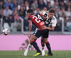 TURIN, Oct. 21, 2018  Juventus' Paulo Dybala (R) vies with Genoa's Daniel Bessa during an Italian Serie A soccer match between FC Juventus and Genoa in Turin, Italy, Oct. 20, 2018. The match ended 1-1. (Credit Image: © Alberto Lingria/Xinhua via ZUMA Wire)