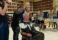 "A whipped cream slam dunk was given to Steve O'Riordan by Kenny Linkkila during the ""Pie a Teacher fundraiser to benefit The Doorway at LRGH on Friday afternoon at Gilford High School.  (Karen Bobotas/for the Laconia Daily Sun)"