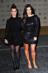 (LtoR) Kourtney Kardashian with Kim Kardashian during the launch of the Kardashians' new clothing and handbag range for Dorothy Perkins, before it goes on sale in 250 stores across the UK, Aqua, London, United Kingdom, November 8, 2012. Photo by Nils Jorgensen / i - Images.