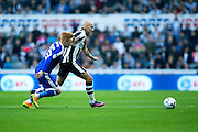 Newcastle United midfielder Jonjo Shelvey (#12) takes on Brentford midfielder Ryan Woods (#15) during the EFL Sky Bet Championship match between Newcastle United and Brentford at St. James's Park, Newcastle, England on 15 October 2016. Photo by Craig Doyle.