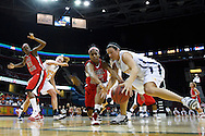 13 March 2010:   Ball State's Shanee' Jackson (10) and Toledo's Allie Clifton (11) during the MAC Tournament game basketball game between Ball State and Toledo and  at Quicken Loans Arena in Cleveland, Ohio.