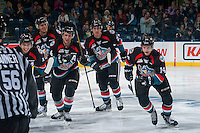 KELOWNA, CANADA - OCTOBER 21: Nick Merkley #10, Calvin Thurkauf #27, Gordie Ballhorn #4, Cal Foote #25 and Jake Kryski #14 of the Kelowna Rockets celebrate a goal against the Tri-City Americans on October 21, 2016 at Prospera Place in Kelowna, British Columbia, Canada.  (Photo by Marissa Baecker/Shoot the Breeze)  *** Local Caption ***