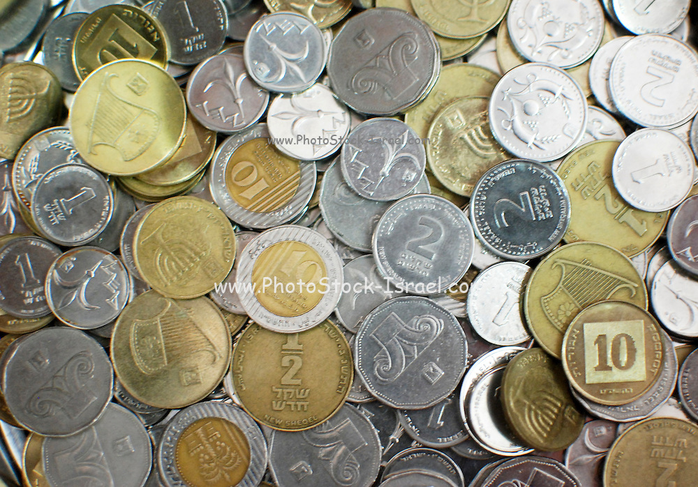 a pile of different Israeli coins