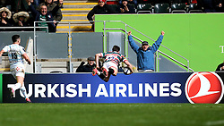 Freddie Burns of Leicester Tigers flies through the air to score a try in front of the Turkish Airlines advertising board - Mandatory by-line: Robbie Stephenson/JMP - 23/10/2016 - RUGBY - Welford Road Stadium - Leicester, England - Leicester Tigers v Racing 92 - European Champions Cup