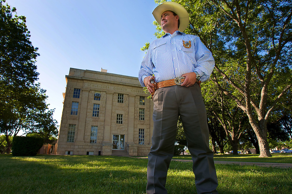 Schleicher County Sheriff David Doran poses for a photo in front of the .Schleicher County Courthouse in Eldorado, Texas on Tuesday June 3, 2008. August MIller/ Deseret News  THIS IS MY FAVORITE.