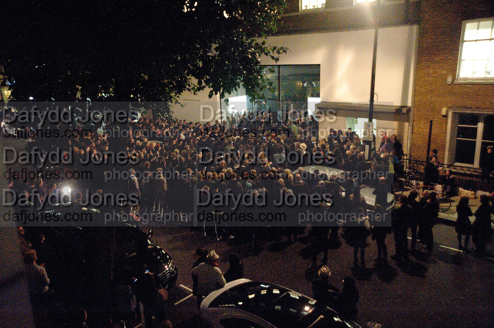 PATTI SMITH PERFORMING OUTSIDE, Robert Mapplethorpe's A Season in Hell. Alison Jacques Gallery and afterwards at the Sanderson Hotel. Berners St. London. 13 October 2009. *** Local Caption *** -DO NOT ARCHIVE-© Copyright Photograph by Dafydd Jones. 248 Clapham Rd. London SW9 0PZ. Tel 0207 820 0771. www.dafjones.com.<br /> PATTI SMITH PERFORMING OUTSIDE, Robert Mapplethorpe's A Season in Hell. Alison Jacques Gallery and afterwards at the Sanderson Hotel. Berners St. London. 13 October 2009.