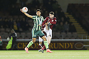 Lyle Taylor of AFC Wimbledon and Ricky Holmes of Northampton Town FC tussle during the Sky Bet League 2 match between Northampton Town and AFC Wimbledon at Sixfields Stadium, Northampton, England on 1 March 2016. Photo by Stuart Butcher.