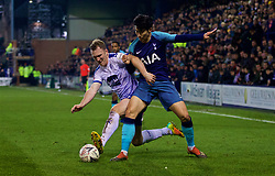 BIRKENHEAD, ENGLAND - Friday, January 4, 2019: Tranmere Rovers' Mark Ellis (L) and Tottenham Hotspur's Son Heung-min during the FA Cup 3rd Round match between Tranmere Rovers FC and Tottenham Hotspur FC at Prenton Park. (Pic by David Rawcliffe/Propaganda)