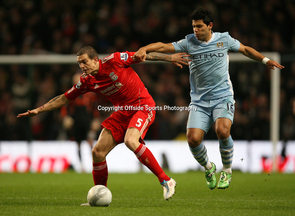 11/01/2012 - Carling Cup Semi-Final (1st Leg) - Manchester City vs. Liverpool - Daniel Agger of Liverpool battles with Sergio Aguero of Man City - Photo: Simon Stacpoole / Offside.