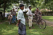 An extended family arrive at a government compound in the town of Debiganj to sign documents. Originally they asked if they could go to India after the disbanding of the enclaves but later changed their mind and decided to stay. Their request was allowed and formalised on this day.<br /> <br /> On July 31st 2015 the enclaves that formed one of the world's most complicated borders were officially absorbed in to the countries that surrounded them in a land-mark land swap between India and Bangladesh. The people that lived in them will finally receive citizenship.<br /> <br /> Enclaves are small pockets of sovereign land completely surrounded by another sovereign nation. Approximately 160 enclaves, known as chitmahals, exist on either side of the India-Bangladesh border. For 68 years the 50,000 plus inhabitants of these enclaves have lived a difficult existence, stranded from their home nation and ignored by the country that surrounds them. <br /> <br /> In theory even leaving their enclaves is illegally crossing an international border and for decades it has been very difficult for them to receive even the most basic of rights whether education or health. Even the police have no jurisdiction in the enclaves leaving them essentially lawless.