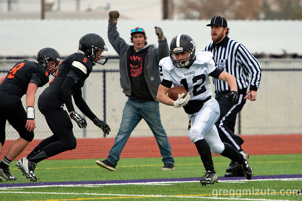 Vale senior running back Zac Jacobs runs past two Scio defenders Dru Cook and Brody Foster for a 35 yard touchdown run to put Vale up 14-0 in the 3A semifinal playoff game at Kennison Field, Hermiston, Oregon, Saturday, November 21, 2015.<br /> <br /> Jacobs finished with 267 rushing years and four touchdowns in Vale's 42-14 win.
