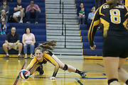 Grace Chlebove of Honeoye Falls-Lima dives for a ball during a match against Pittsford Sutherland in Pittsford on Thursday, September 15, 2016.