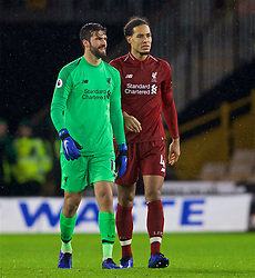 WOLVERHAMPTON, ENGLAND - Friday, December 21, 2018: Liverpool's goalkeeper Alisson Becker and Virgil van Dijk after the FA Premier League match between Wolverhampton Wanderers FC and Liverpool FC at Molineux Stadium. (Pic by David Rawcliffe/Propaganda)