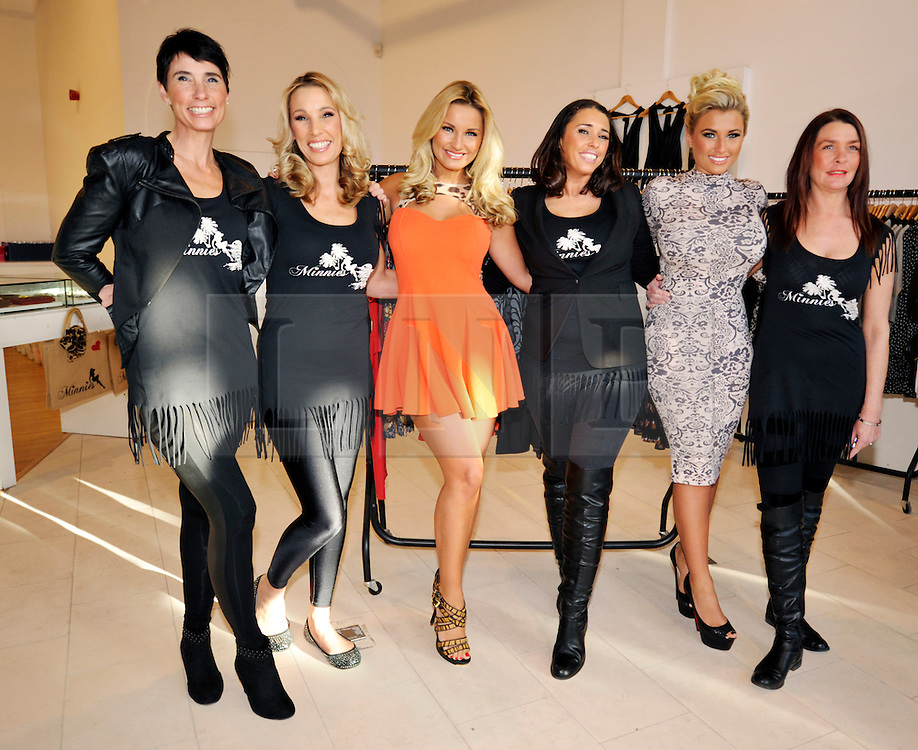 © Licensed to London News Pictures. 02/02/2013. Bristol, UK. Middle four left-right: Sue Wells (mum of the Faiers twins),  Sam Faiers from TOWIE, their aunt Libby Low, Billie Faiers from TOWIE, at the opening of the Minnies Boutique pop-up shop in Bristol's Cabot Circus shopping centre.  02 February 2013..Photo credit : Simon Chapman/LNP