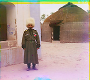 What Russian Empire Looked Like Before 1917… In Colour<br /> <br /> <br /> The Sergei Mikhailovich Prokudin-Gorskii Collection features colour photographic surveys of the vast Russian Empire made between ca. 1905 and 1915. Frequent subjects among the 2,607 distinct images include people, religious architecture, historic sites, industry and agriculture, public works construction, scenes along water and railway transportation routes, and views of villages and cities. An active photographer and scientist, Prokudin-Gorskii (1863-1944) undertook most of his ambitious colour documentary project from 1909 to 1915. <br /> <br /> Photo Shows; Man in uniform beside building, yurt in background. (between 1905 and 1915)<br /> ©Library of Congress/Prokudin-Gorskii/Exclusivepix Media