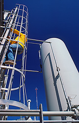 Chemical Plant Operator Climbing Ladder