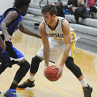 Trask's Chris Holmes guards Topsail's Jake Sullivan Friday December 5, 2014 at Topsail High School in Hampstead, N.C. (Jason A. Frizzelle)