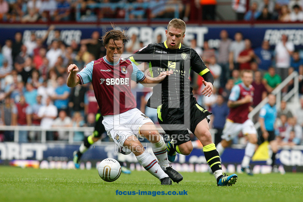 Picture by Daniel Chesterton/Focus Images Ltd. 07966 018899.21/8/11.Scott Parker of West Ham and Adam Clayton of Leeds during the Npower Championship match at Upton Park stadium, London.
