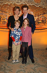 JAMES & JULIA OGILVY he is the son of Princess Alexandra, and their children ALEXNADER & FLORA at a children's party in aid of the charity Over The Wall held at Fortnum & Mason, Piccadilly, London before a gala premiere of the new musical Mary Poppins at The Prince of Wales Theatre, Old Compton Street, London W1<br /><br />NON EXCLUSIVE - WORLD RIGHTS
