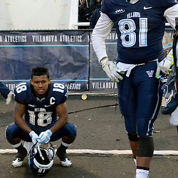 TOM KELLY IV &mdash; DAILY TIMES<br /> Villanova's Poppy Livers (18) and Earnest Pettway (81) show their emotions after they were defeated by SHS during the Sam Houston State University at Villanova University NCAA FCS Division 1 - AA quarterfinal game at Villanova Stadium.
