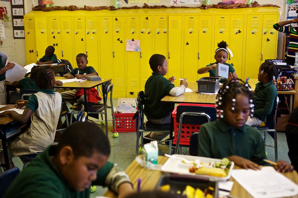 Third grade students do classwork at Adelaide Davis Elementary School on Nov. 26, 2012 in Washington, D.C. Last week DCPS Chancellor Kaya Henderson proposed closing 20 under-enrolled schools in the District. Davis Elementary is one of 20 schools in the DCPS system included in the school closure proposal. There are currently 178 students enrolled in Davis Elementary and the second floor of the school is only used for music classes and the library...CREDIT: Lexey Swall for The Wall Street Journal.DCSCHOOLS