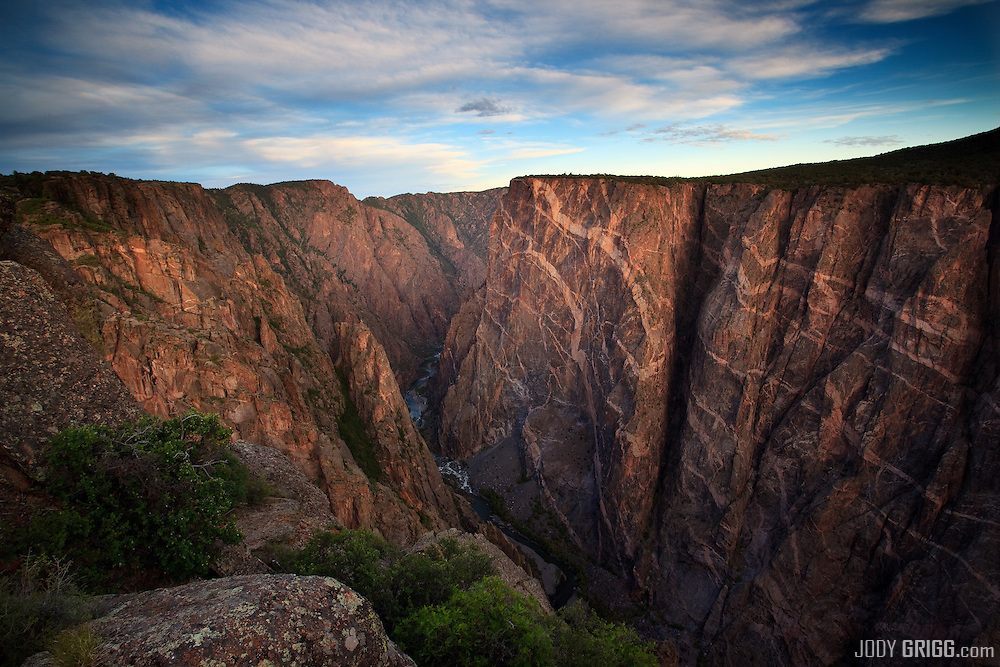 Sunrise strikes the 'Painted Wall' in the Black Canyon of the Gunnison National Park near Montrose, Colorado.