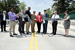 With a ribbon cutting ceremony atop of Willow Grove Avenue Bridge city officials, community members and local church representatives celebrate the opening on Wednesday.