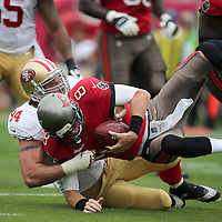 San Francisco 49ers defensive end Justin Smith (94) sacks Tampa Bay Buccaneers quarterback Mike Glennon (8) during an NFL football game between the San Francisco 49ers  and the Tampa Bay Buccaneers on Sunday, December 15, 2013 at Raymond James Stadium in Tampa, Florida.. (Photo/Alex Menendez)
