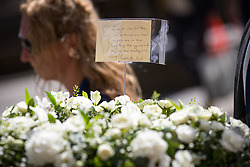 © Licensed to London News Pictures. 03/06/2018. London, UK. Flowers displaying a note from the Metropolitan Police Commissioner Cressida Dick, marking one year since the London Bridge and Borough Market terror attacks. A series of events have taken place throughout the day, including a service of commemoration at Southwark Cathedral, the planting of an olive tree in the Cathedral grounds, a minute's silence at 4:30pm and the laying of flowers.  Photo credit : Tom Nicholson/LNP