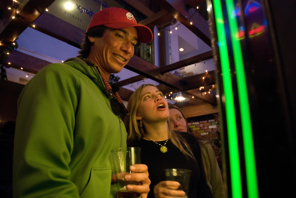 Friends share pints and music at a local pub in Durango ,Colorado. Young people enjoy the Night Life in Durango, Colorado