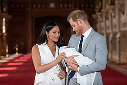 "File photo dated 08/05/19 of the Duke and Duchess of Sussex with their baby son Archie Harrison Mountbatten-Windsor, during a photocall in St George's Hall at Windsor Castle in Berkshire. The royal couple have announced they are to ""step back"" as senior members of the royal family and will now divide their time between the UK and North America."