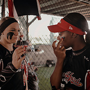 Outfielder, Kiki Stokes, applies eye black prior to the game.<br /> <br /> Todd Spoth for The New York Times.